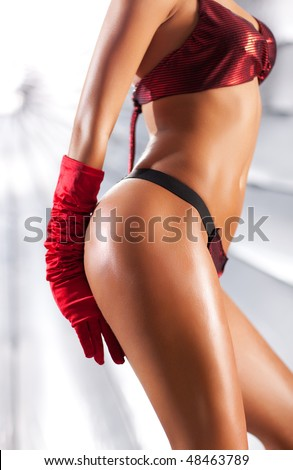 Young sexy woman. On big bright silver umbrella background. - stock photo