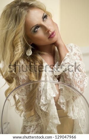 Young sexy woman on chair. - stock photo