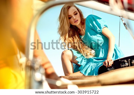 Young sexy woman on private yacht - stock photo