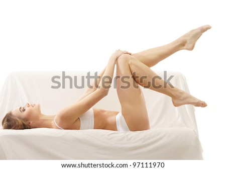 Young sexy woman on the sofa - stock photo