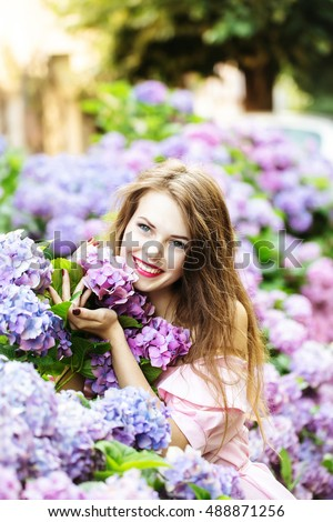 stock photo young sexy woman or girl with long brunette hair and red lips on pretty smiling face in blooming 488871256