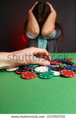 young sexy woman playing poker. Emotions, loss. - stock photo
