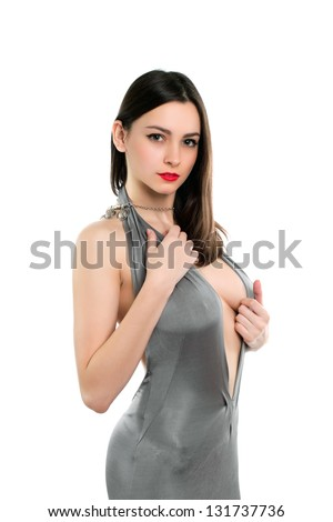 Young sexy woman posing in frank grey dress. Isolated on white - stock photo