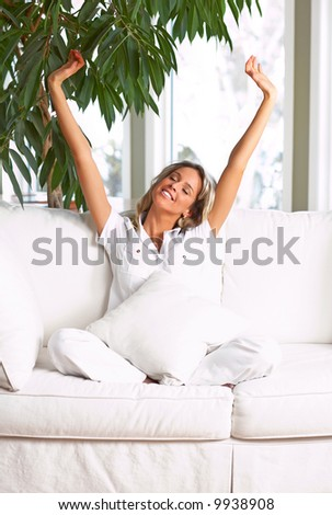Young sexy woman relaxation  in the comfortable apartment - stock photo