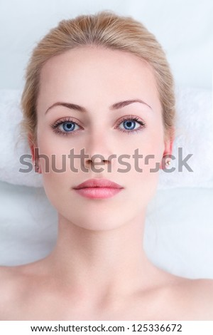 Young sexy woman relaxing in spa - stock photo