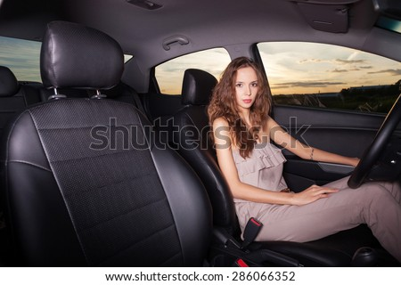 Young sexy woman sitting in the car driving  - stock photo