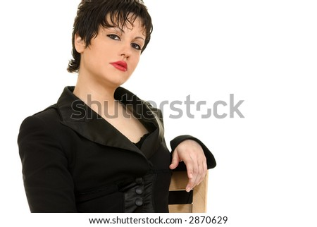 Young sexy woman sitting on a chair