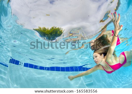 Young sexy woman swimming underwater - stock photo
