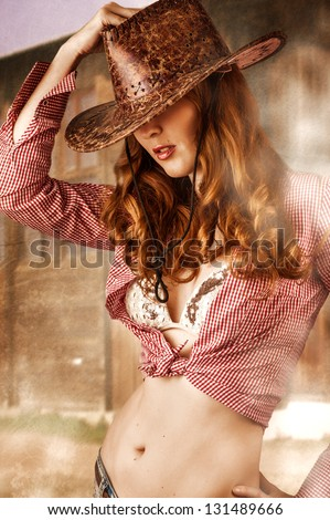 Young sexy Woman wearing cowboy hat - stock photo