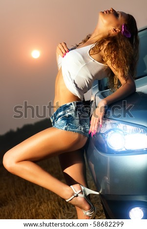 Young sexy woman with car. - stock photo