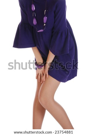 Young sexy woman with her legs crossed over white background - stock photo