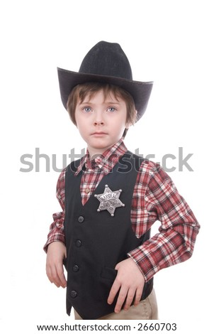 Young sheriff boy wearing a marshals badge and a cowboy hat isolated over white - stock photo