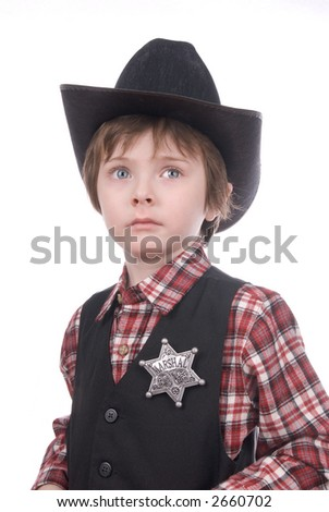 Young sheriff boy wearing a marshals badge and a cowboy hat over white - stock photo