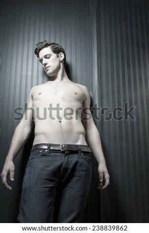 Young Shirtless Caucasian Man With Athletic Body - stock photo