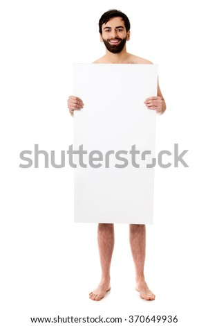 Young shirtless man holding empty banner. - stock photo