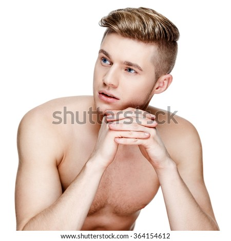 Young shirtless man isolated on white - stock photo