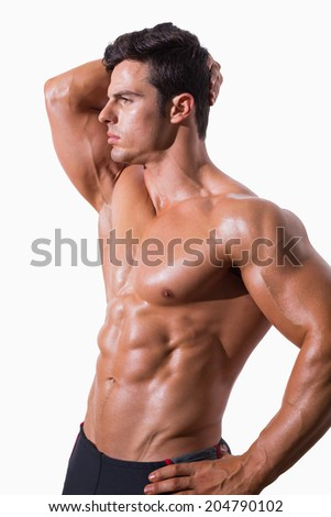 Young shirtless muscular man posing over white background - stock photo