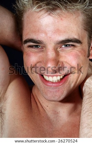 Young shirtless muscular model smiling