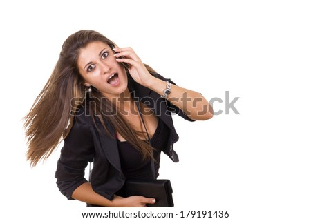 young shocked business woman talking on the phone - stock photo