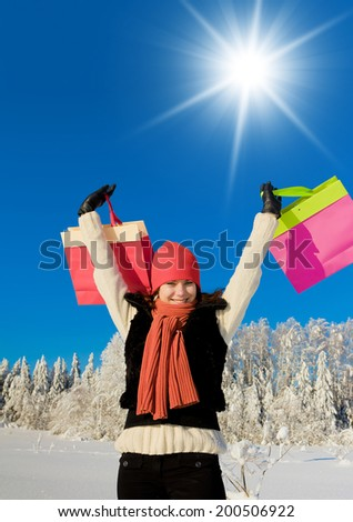 Young Shopper Enjoying the Snow  - stock photo