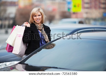 Young shopper on a car parking - stock photo
