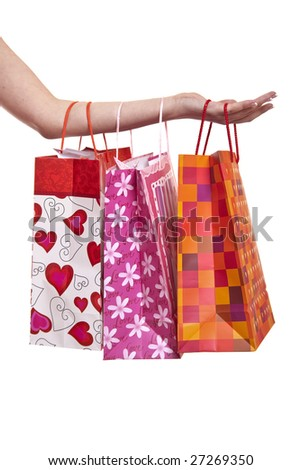 Young shopper - woman's hand with shopping bags