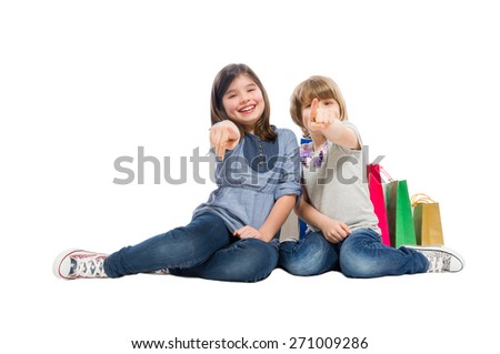 Young shopping sisters or daughters pointing fingers to the camera - stock photo
