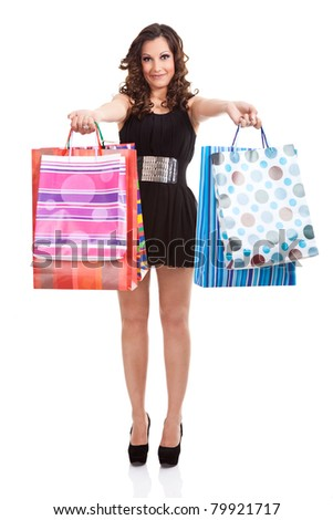 young shopping woman showing shopping bags, isolated on white background - stock photo