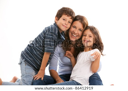 Young single parent family having fun isolated on a white background. - stock photo