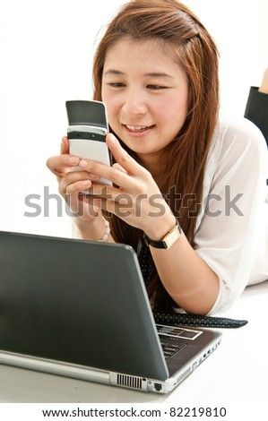 Young Sister  searching internet and Chatting with her friend in network internet. - stock photo