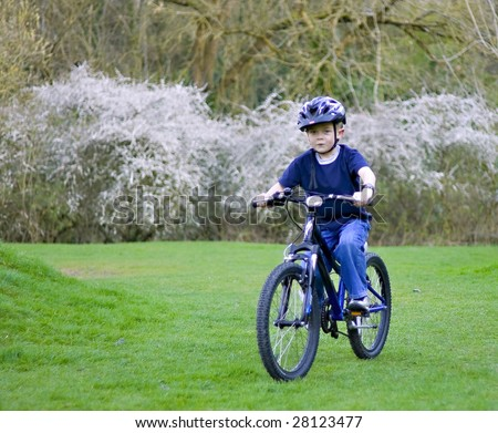 young six year old boy riding his bike