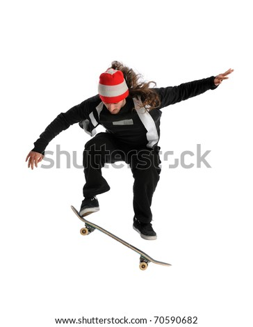 Young skateboarder jumping performing a trick isolated over white background - stock photo