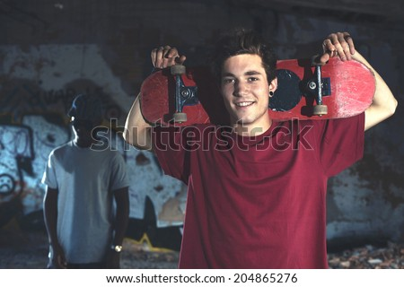 Young skaters ready to show his skills in an urban place - stock photo