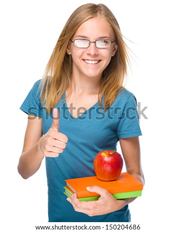 Young skinny student girl is holding exercise book and apple, isolated over white - stock photo