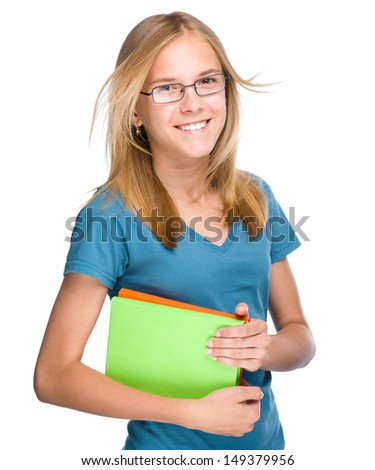 Young skinny student girl is holding exercise books, isolated over white - stock photo