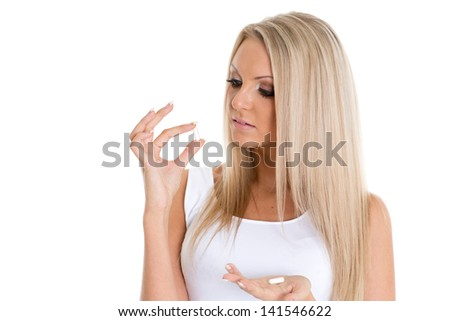 Young slender woman with pills on a white background. Fat burner. - stock photo