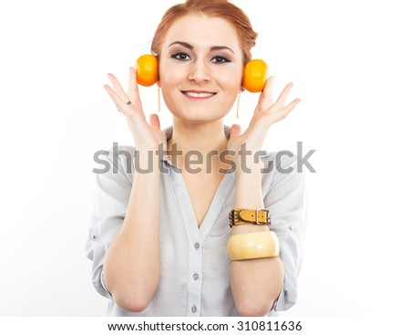 Young slim girl with tangerines. Portrait of a woman on a diet. Tasty and useful. Counting calories. Portrait of a girl isolated on a white - stock photo