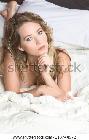 Stock photo young slim petite caucasian woman on bed 113744572 jpg