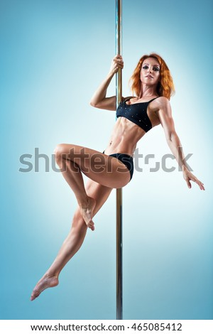 Young slim sexy pole dance woman in black lingerie