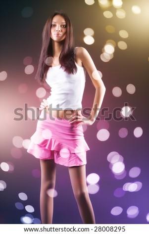 Young slim woman. Blur spots effect. - stock photo
