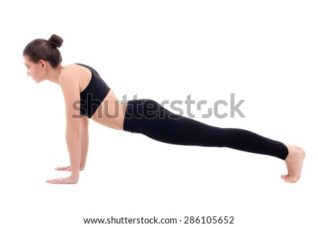 young slim woman doing push up exercise isolated on white background
