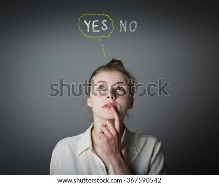 Young slim woman full of doubts and hesitation. Yep concept. - stock photo