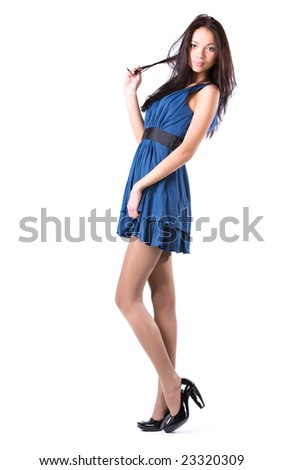 Young slim woman in blue dress. Isolated on white. - stock photo