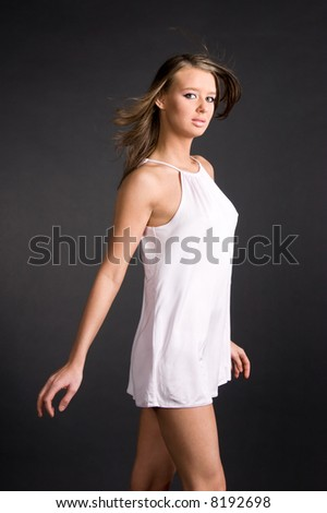 Young slim woman in white shirt. - stock photo