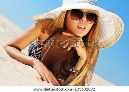 Young slim woman on beach portrait. - stock photo