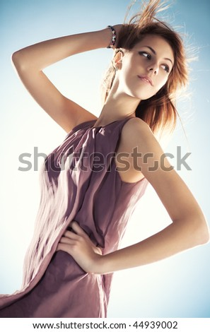 Young slim woman with fluttering hair portrait.