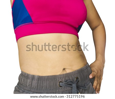 Young slim woman with little fat on her belly on white background