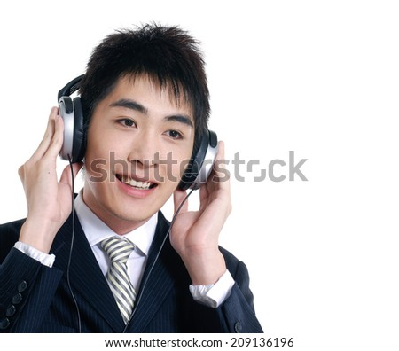young smile business man listening to music on white - stock photo