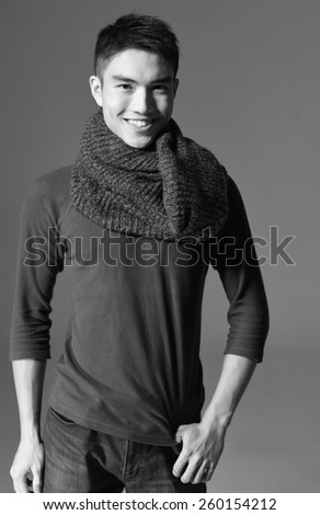 young smile man standing with hands in pockets posing - stock photo