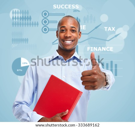 Young smiling African-american businessman over blue background. - stock photo
